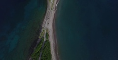 Aerial crossing over the Scott's Head peninsula from ocean to sea Stock Footage