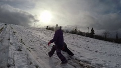 Brother and sister playing in the snow slow motion Stock Footage
