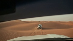 Desert Safari SUVs bashing through the arabian sand dunes. View from the car Stock Footage