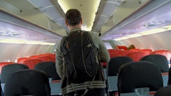 Male passenger proceeding to exit of airplane Stock Footage