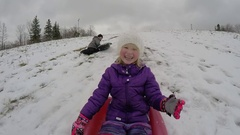 Brother and sister having fun sledding Stock Footage