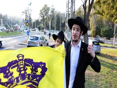 Young Hassidic Jews with flag try to attract to the Messiah Stock Footage