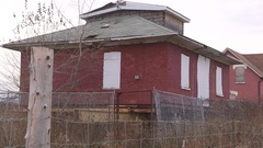 Abandoned and foreclosed home all boarded up with no trespassing signs Stock Footage