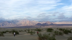 Zooming motion timelapse of mountains and sand dunes in Death valley, Califor Stock Footage