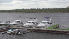 Boats and yachts on a mooring in the harbor. Stock Footage