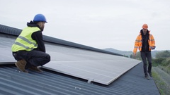 4K Technicians checking the panels at solar energy installation Stock Footage