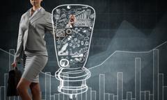 Woman sketching business ideas Stock Photos