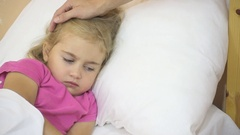 Sick little girl having her temperature.  Child with a fever: Stock Footage