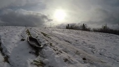 Passing sled on snowy hill Stock Footage