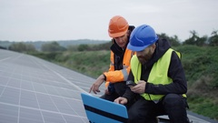 4K Technician with laptop checking the panels at solar energy installation Stock Footage