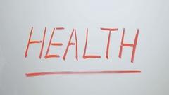 Erasing the word HEALTH Stock Footage