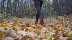 Man jogging cross country running on trail in forest. Stock Footage