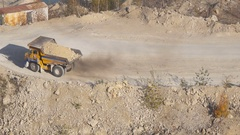 Mining trucks in giant open pit mine, heavy mining truck Stock Footage
