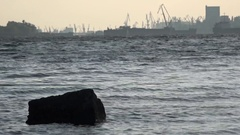 City on the horizon, a seaside port. Stock Footage