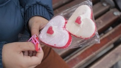Candy heart in hands Stock Footage