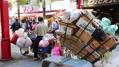 Recycling garbage collection at  Ximen shopping district, Taipei Taiwan Stock Footage
