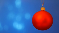Red christmas ball on blue background. Stock Footage
