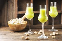 Italian traditional liquor with pistachio Stock Photos