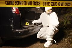 Collecting odor traces in criminal car trunk Stock Photos