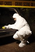 Criminologist collecting odor traces Stock Photos