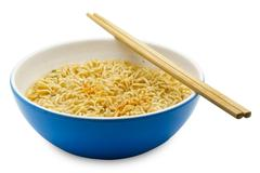 Cooked instant rice noodles in a blue bowl Stock Photos