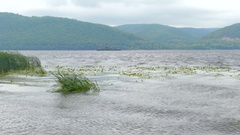 Waves on the shore of the river Volga, Russia. A storm in autumn day. Stock Footage