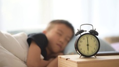 Boy wake up and play phone Stock Footage