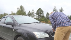 Men opens the car hood and visually inspects examines the motor engine Stock Footage