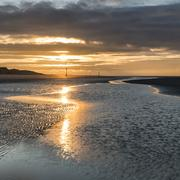 Beautiful beach coastal landscape image at sunrise with colorful vibrant sky Stock Photos