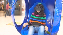Young woman on virtual reality glasses play virtual environment. Stock Footage