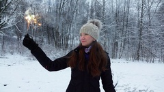 Merry girl hold burning sparkler stick, show it to camera, slow motion Stock Footage