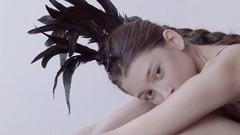 Young mixed race caucasian woman vogue portrait with feather mohawk accessory Stock Footage