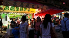 HONG KONG - Evening view of wet market with people. 4K resolution. Stock Footage