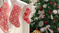 Girl hang up a stocking Stock Footage