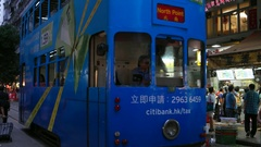 HONG KONG -  Evening view of wet market with people and double-decker tram. 4K Stock Footage