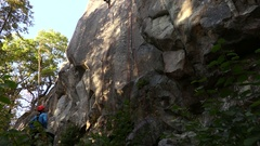 Climbing in Sweden on a sunny day with a nice view and a nice blue sky Stock Footage