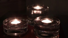 Heat candle burning in a candlestick Stock Footage