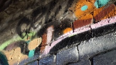 Abstract graffiti detail with water reflections by a Birmingham canal. Stock Footage