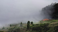 Rural house disappearing in fog - misty weather landscape in cloud Stock Footage