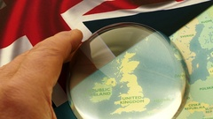 Dome magnifier pushed across a map, highlighting the UK. Stock Footage