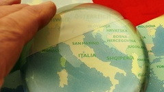 Dome magnifier pushed across a map, highlighting Italy. Stock Footage