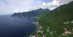 Aerial pulls back to reveal the town of Scott's Head on the south of Dominica Stock Footage