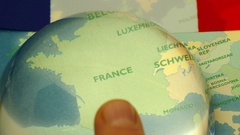 Dome magnifier pushed across a map, highlighting France. Stock Footage
