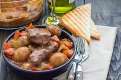 Hearty beef stew with carrot, celery, shallot and potato, horizontal, copy space Stock Photos