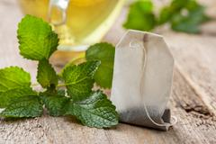 Tea bag with mint Stock Photos