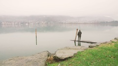 Fisherman catches a fish on the lake Stock Footage