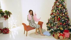 Girls having fun in their pajamas near the Christmas tree Stock Footage