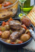 Hearty beef stew with carrot, celery, shallot and potato, vertical Stock Photos
