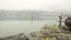 Fisherman on the lake in a cloudy day Stock Footage