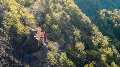 Brave Man Slacklining Above Autumn Trees Season Nature Danger Adventure Leisure Stock Footage
